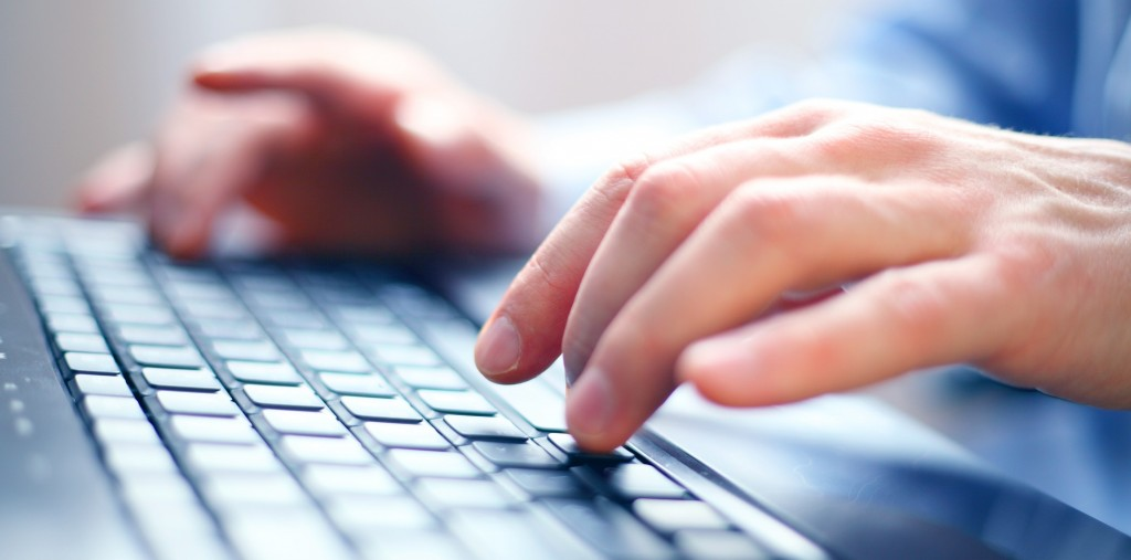 image of a client using our services in hampshire typing on a keyboard